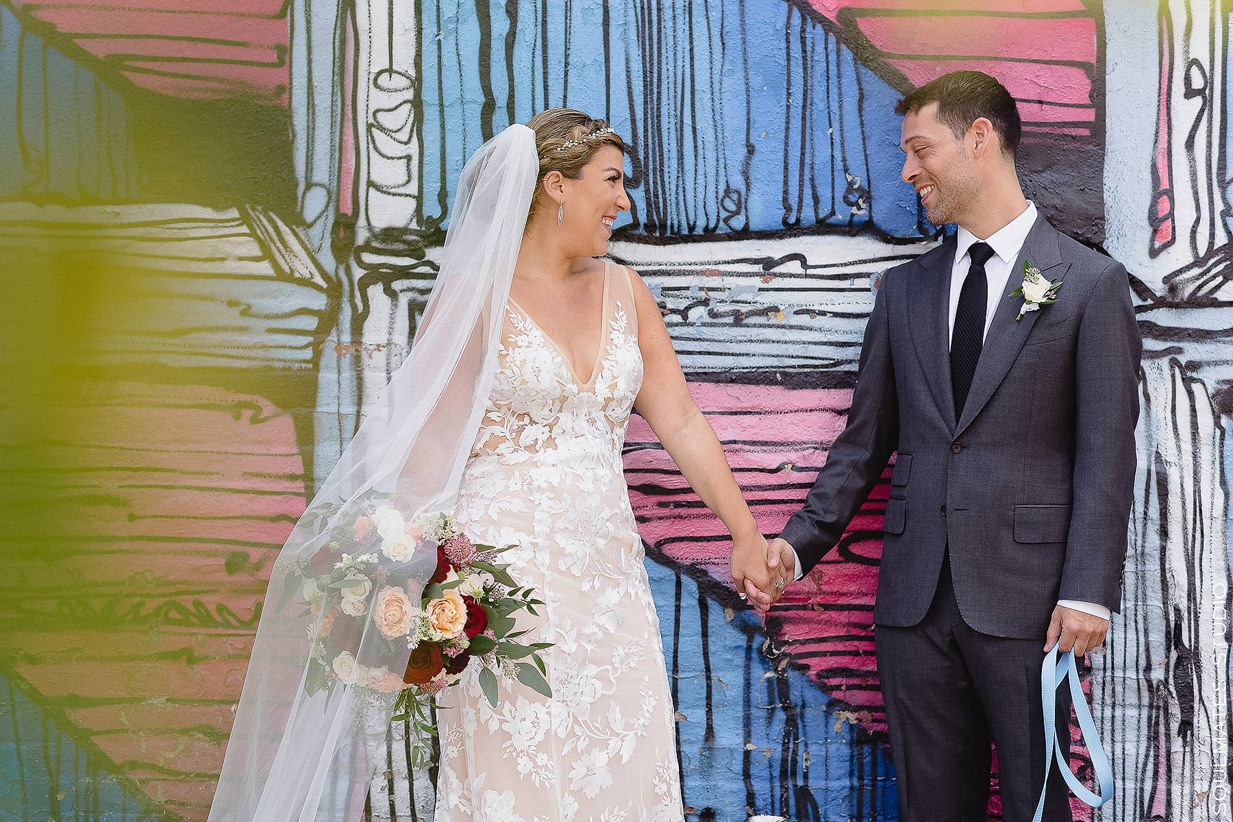 Bride and Groom Wedding Portrait in Jersey City by street art wall