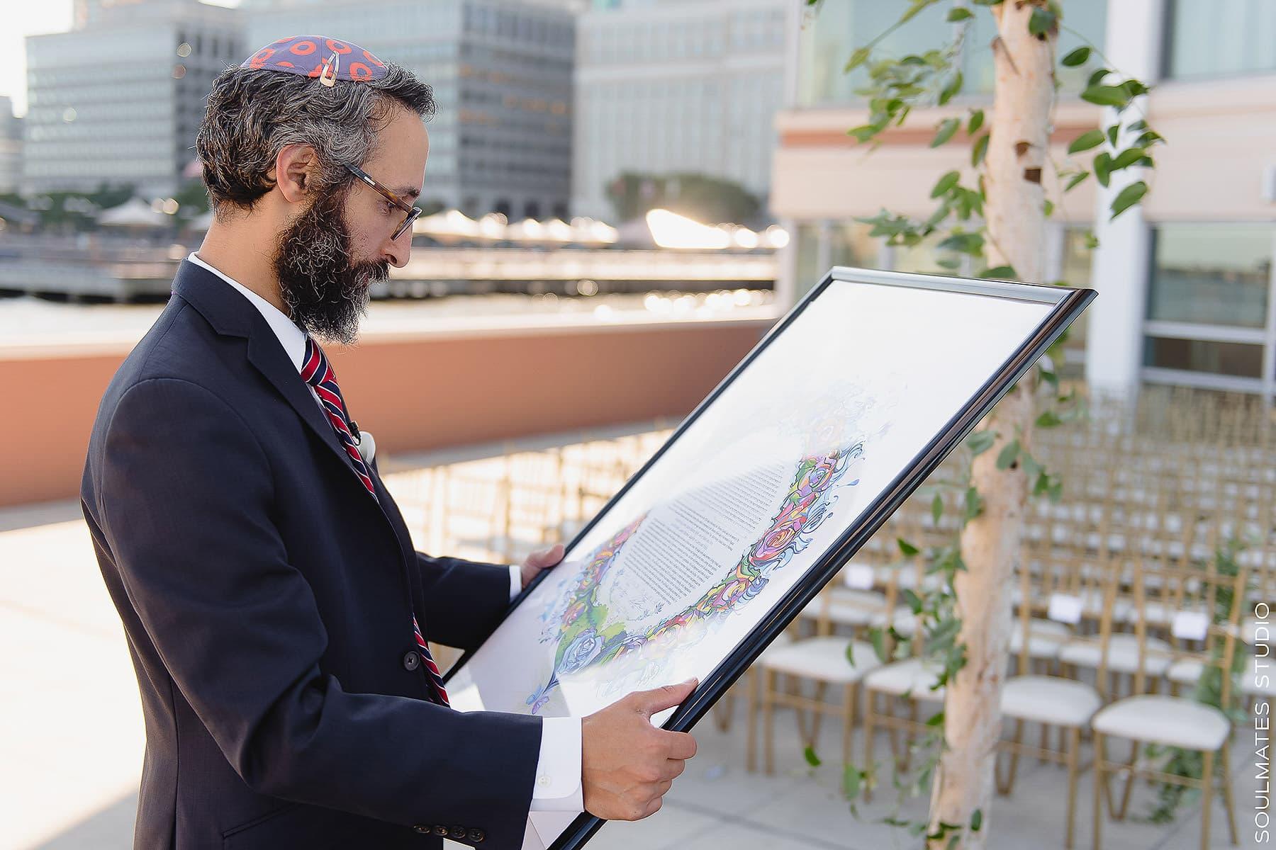 Rabi is looking at Ketubah before Jersey City Wedding