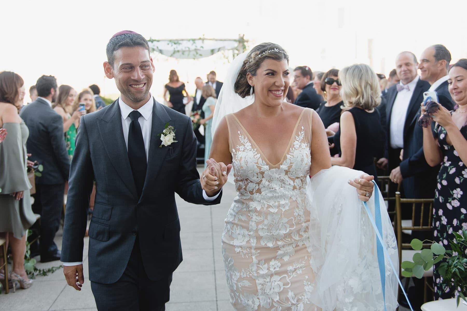 Bride and Groom leaving wedding ceremony at Jersey City Hyatt Regency