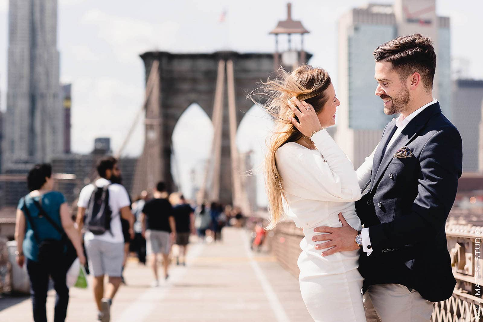 Engaged Couple laughing on the Brooklyn Bridge