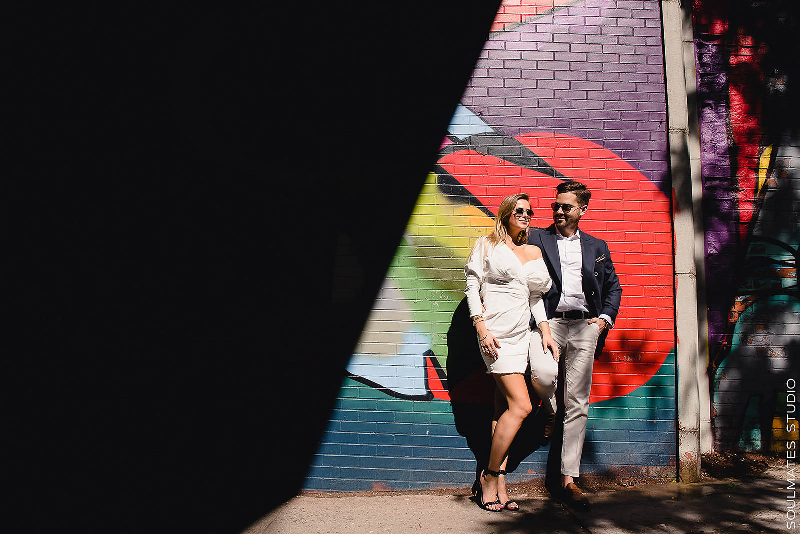 DUMBO Colorful art wall as a backdrop for the couple